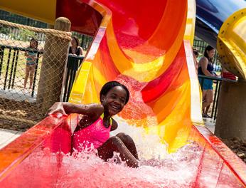 girl sliding down a waterslide
