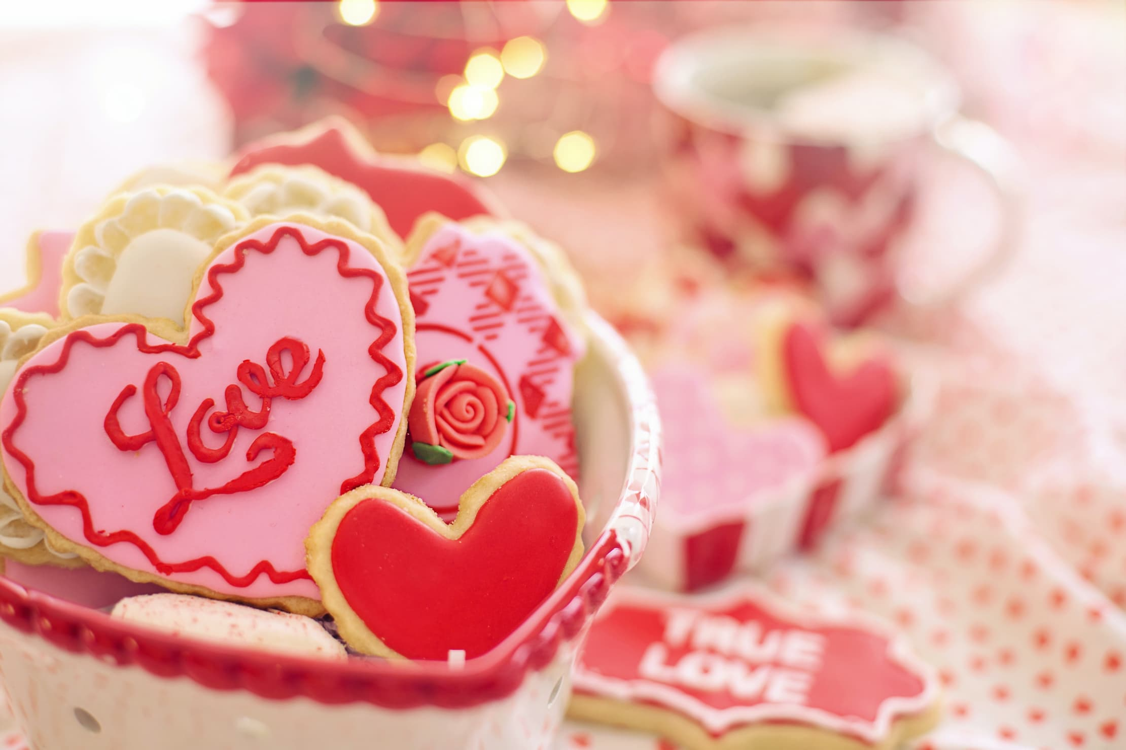 heart shaped cookies on a table with one with the word Love