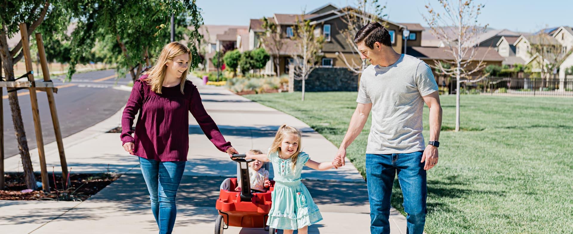 family walking on sidewalk at Ellis